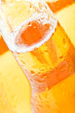 Beer bottle abstract. Wet bottle, macro with focus on fill-line Stock Photography