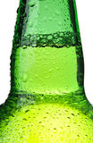 Beer bottle abstract isolated. Beer bottle abstract closeup, green wet bottle with water droplets Stock Image