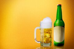 Free Beer Bottle And Glass Of Cold Beer With A Yellow Background Royalty Free Stock Photos - 191861758