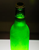 Beer bottle on bar table Royalty Free Stock Photos