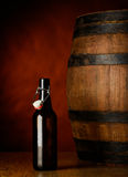 Beer bottle and barrel Stock Photo
