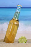 Beer in bottle on the beach and sand Royalty Free Stock Photo