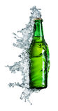 Beer bottle being poured in a water. On white Royalty Free Stock Photography