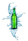 Beer bottle being poured in a water. On white Stock Photography
