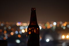 Beer bottle with blurred background Stock Photo