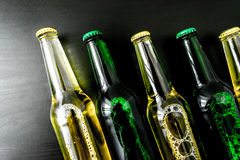 Beer in bottle with bubbles closeup Stock Photo