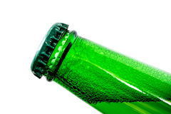 Beer in bottle with bubbles closeup isolated Royalty Free Stock Photos