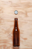 Beer bottle and cap Stock Photos