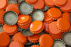 Beer Bottle Caps. Beer bottle cap background.  These are used by home brewers for bottling their home brewed beer Stock Photo