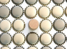 Beer bottle caps and wine cork Royalty Free Stock Photography