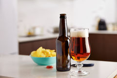 Beer bottle with chips Royalty Free Stock Photo