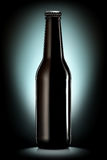Beer bottle or cider isolated on black background. Bottle of beer or cider with clipping path isolated on black background Stock Photos