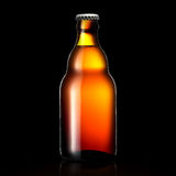 Beer bottle or cider isolated on black background. Bottle of beer or cider with clipping path isolated on black background Royalty Free Stock Photography