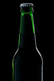 Beer bottle close-up over black Royalty Free Stock Image