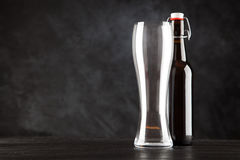 Beer bottle on dark background Royalty Free Stock Images