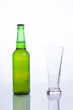 Beer bottle and empty mug Stock Photos
