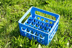 Beer bottle empty plastic crate on grass Stock Photography