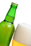 Beer is in a bottle and glass Royalty Free Stock Image