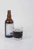 Beer bottle and glass. Stock Images