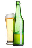 Beer in bottle and glass isolated. On white Royalty Free Stock Photography