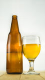 Beer bottle and goblet Royalty Free Stock Photo