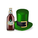 Beer bottle and green hat isolated Royalty Free Stock Photography