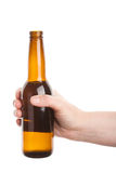 Beer bottle in the hand Stock Photos