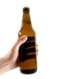 Beer bottle in the hand Royalty Free Stock Photos
