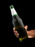 Beer bottle in hand Stock Photography