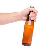 Beer bottle hand. One beer bottle in a hand on the white background Royalty Free Stock Image