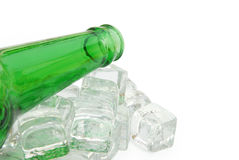 Beer bottle and ice Stock Photography