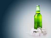 Beer bottle in ice cubes Stock Photo
