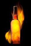Beer Bottle In Fire On Black Stock Photo