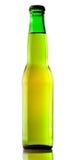 Beer bottle lit backlight Royalty Free Stock Images