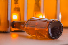 Beer bottle lying down Stock Images