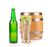 Beer bottle and mug with hops. Royalty Free Stock Photo