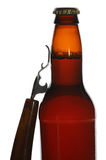 Beer Bottle with Opener Royalty Free Stock Image