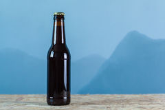 Beer bottle over blue Royalty Free Stock Photos