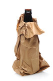 Beer Bottle in Paper Bag Stock Images