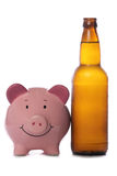 Beer bottle with piggy bank Royalty Free Stock Photos