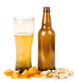 Beer bottle and potato chips Royalty Free Stock Photography