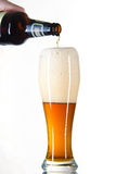 Beer from  bottle poured into a glass Royalty Free Stock Image