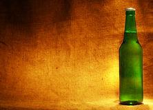Beer bottle on sacking. With copy-space stock photography