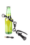 Beer bottle in shackles Stock Images