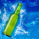 Beer bottle in water Royalty Free Stock Image