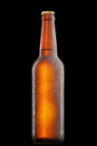 Beer bottle with water drops and frost isolated Royalty Free Stock Image