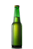 Beer bottle with water drops Stock Photography