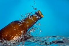 Beer bottle in water Royalty Free Stock Image