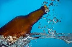Beer bottle in water Stock Image