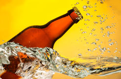 Beer bottle in water Royalty Free Stock Photos